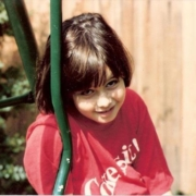 Young girl, sitting on swing, early 1980's
